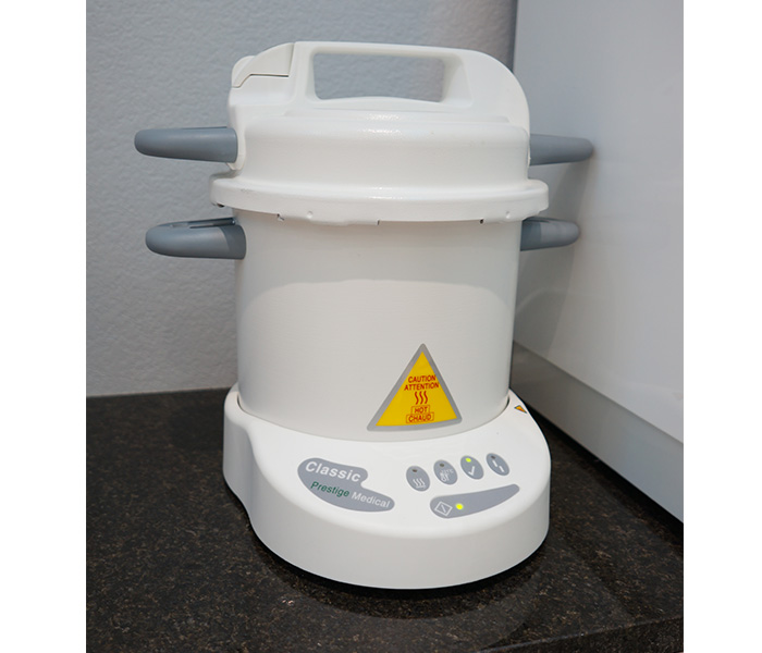 A medical-grade autoclave, used to completely sanitize all metal implements
